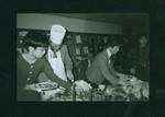 Robert Brandeis serving Christmas meal