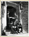 [Male students sitting on Gate House steps]