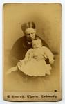 Mrs. Burwash, holding an infant