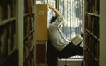 [Student studying at E.J. Pratt Library]