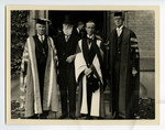 [Lord Tweedsmuir with E.W. Wallace, George Fallis, and another man at 100th anniversary convocation ]