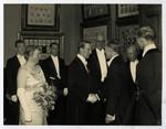 Lord Tweedsmuir greeting Warden of Hart House, Mr. Bickersteth, at 100th anniversary reception