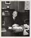 Walter Theodore Brown sitting behind a desk