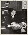 Walter Theodore Brown sitting behind a desk