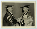 Walter Theodore Brown shaking hands at his installation as Chancellor