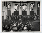 Dr. R.B. McClure delivering the baccalaureate sermon in the Victoria College Chapel to the members of the graduating classes of Victoria College and Emmanuel College, March 1947