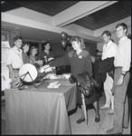 [1980s graduates participating in a raffle at the All Years Gala Reunion]