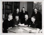 [Walter Theodore Brown with N. Harold Young and unidentified men around a table]