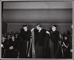 [Dawson Matheson and Hal Bennett robing A.B.B. Moore at his installation]