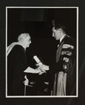 [Mrs. W.W. Andrews receiving Diploma of Honour from A.B.B. Moore at Convocation, 1954]