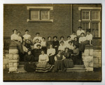 Women residents sitting on steps of Annesley Hall