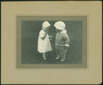 Claire Pratt (in bonnet) with friend