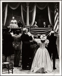 "Raymond Massey and Lillian Gish receiving applause while in theatre box seats in the television production ""The Day Lincoln Was Shot"""