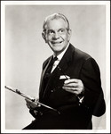 "Raymond Massey holding clipboard as character in ""Dr. Kildare"""