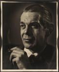 Raymond Massey holding cigarette