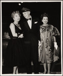 Raymond Massey holding hands with Joan Crawford and Joan Bennett
