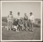 Raymond Massey, Basil Rathbone, David Niven and other players posing on a golf course