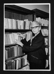 Laure Rièse standing in front of a bookshelf