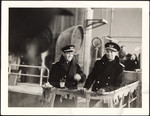 "Raymond Massey and Humphrey Bogart on deck of ship in ""Action In The North Atlantic"""