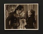 """Merle Oberon as """"Marguerite"""" and Raymond Massey as """"Chauvelin"""" in """"The Scarlet Pimpernel"""""""