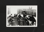 A.B.B. Moore lecturing students in a classroom