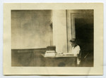 [Miss Barker at the front desk in Birge-Carnegie Building]