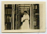 [Miss Barker in the East Stacks of Birge-Carnegie Building]