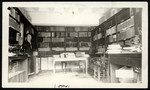 Interior of room 02 in the Birge-Carnegie Library, Mrs. Tewey's work room, contains paper and magazines