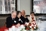 Northrop Frye and others at dining table in the Burwash Hall Private Dining Room for Graduate Christmas lunch