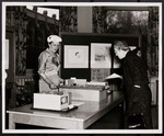 [Two women looking at model of Margaret Addison Hall]