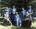 Northrop Frye posing on campus with other honorary degree recipients and two Bishops University officials